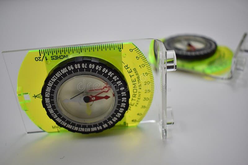 Dois inclinômetro em um fundo branco fotos de stock