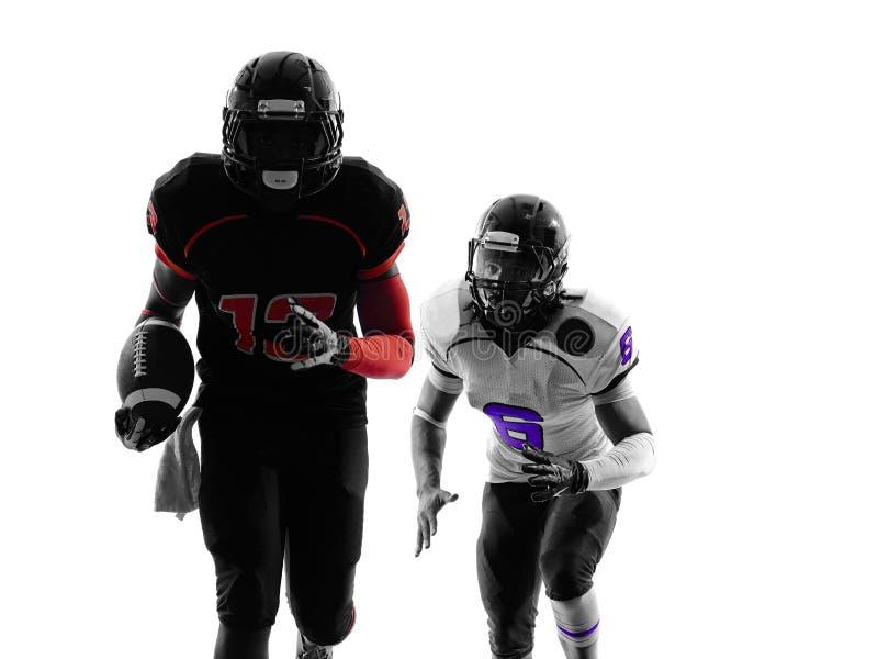 Dois jogadores de futebol americano que correm a silhueta imagem de stock