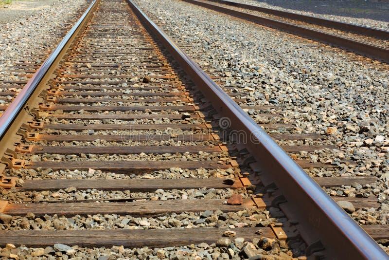 Dois jogos de trilhas do trem fotografia de stock