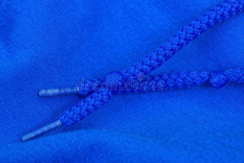 Dois laços azuis connosco na tela da roupa foto de stock royalty free
