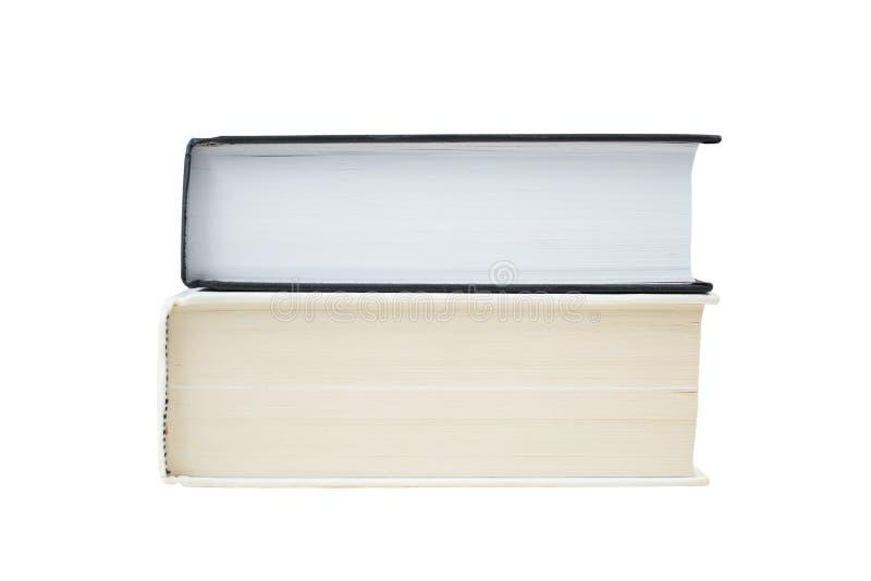 Dois livros de capa dura empilhados isolados junto no fundo branco Branco e livro negro fotografia de stock