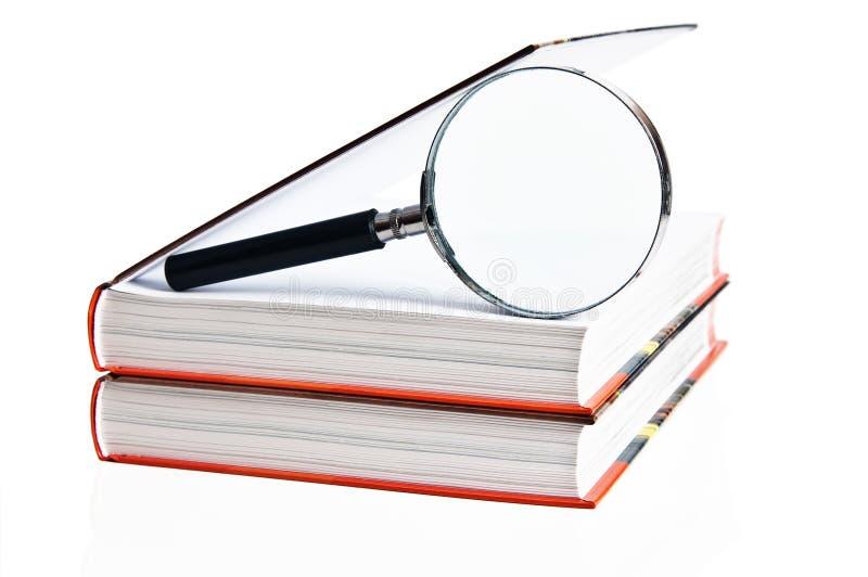 Dois livros e magnifier fotografia de stock royalty free