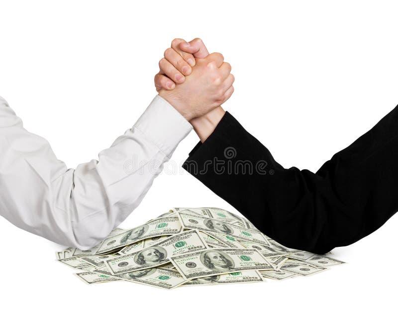 Dois mãos e dinheiros atracando-se fotografia de stock