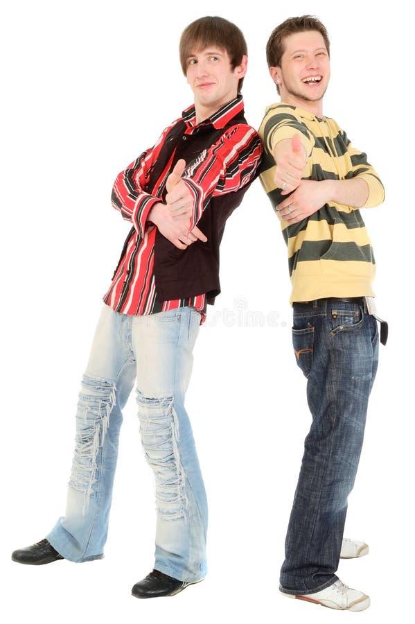 Dois meninos felizes mostram ESTÁ BEM imagem de stock