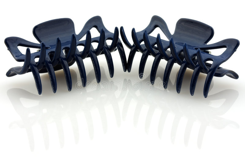 Dois obscuridade - pinos de cabelo azuis, isolados imagens de stock