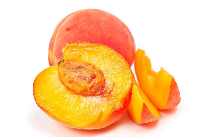 Dois pêssegos no fundo branco foto de stock