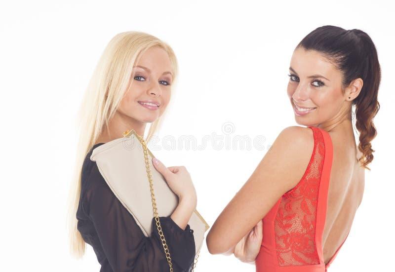 Dois partys girl bonitos no fundo isolado branco imagem de stock royalty free