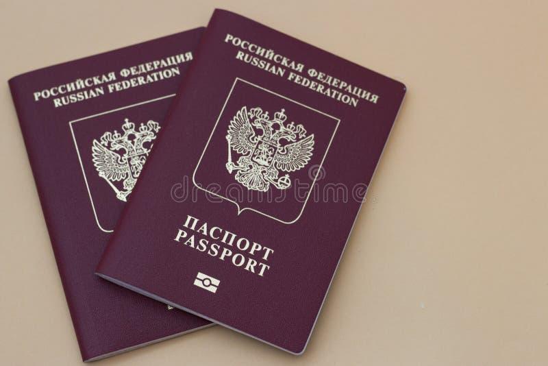 Dois passaportes do russo em um fundo neutro fotos de stock royalty free