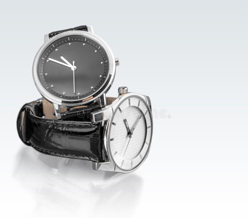 Dois relógios de pulso na tabela branca fotografia de stock royalty free