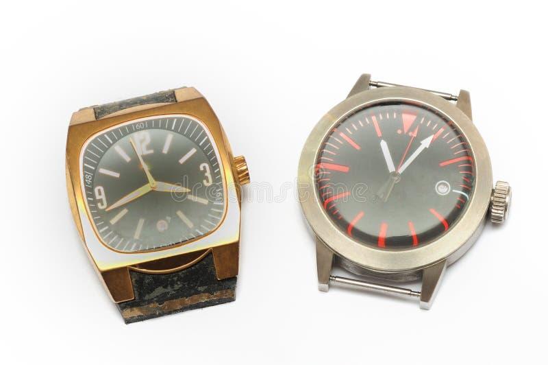 Dois relógios de pulso sem as correias de pulso foto de stock