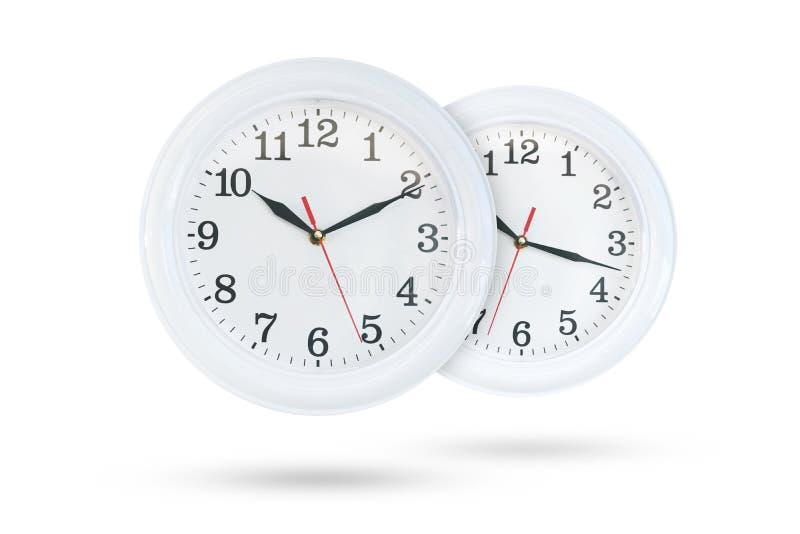 Dois relógios isolados no fundo branco fotos de stock