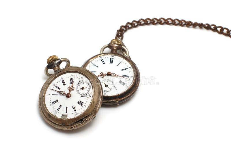 Dois relógios velhos isolados no branco fotos de stock royalty free