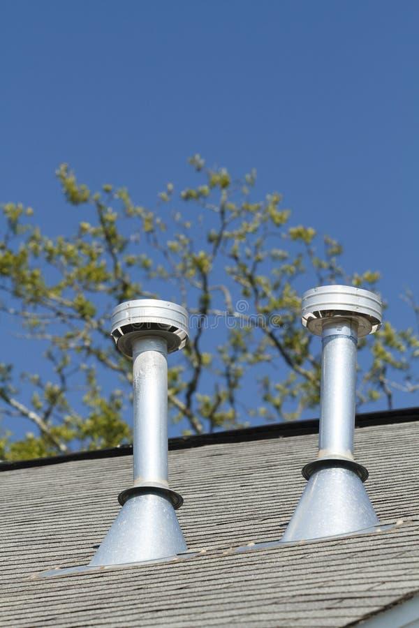 Dois respiradouros residenciais da exaustão do telhado imagem de stock royalty free
