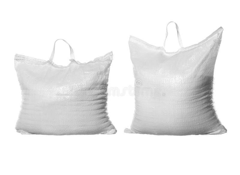 Dois sacos do açúcar refinado do branco imagens de stock