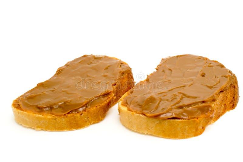 Dois sanduíches com leite condensado do chocolate imagens de stock