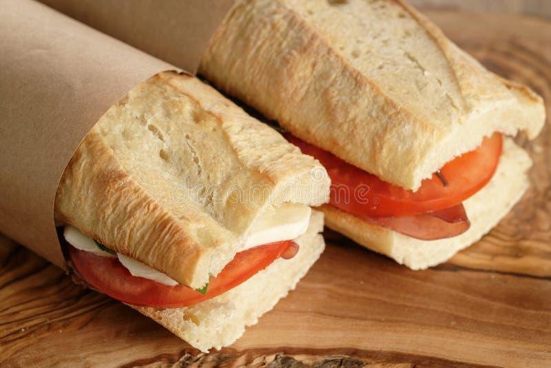 Dois sanduíches italianos caseiros com bresaola e mussarela imagens de stock