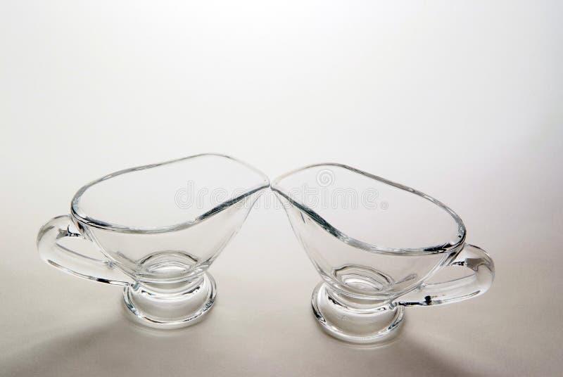 Dois sauce-boats de vidro imagens de stock royalty free