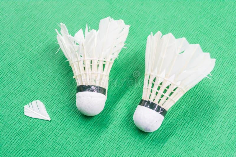 Dois usaram as petecas brancas do badminton imagem de stock royalty free