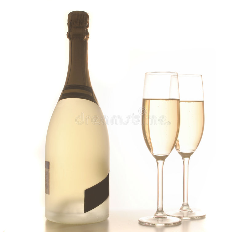 Dois vidros e frascos do champanhe backlit, no branco fotografia de stock royalty free