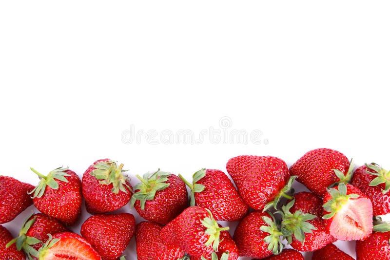 Dojrzałe truskawki odizolowywać na białym tle, makro- zdjęcia royalty free