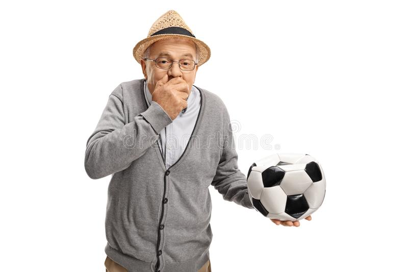 Dojrzały mężczyzna trzyma jego z deflated futbolem oddawał jego mo fotografia royalty free