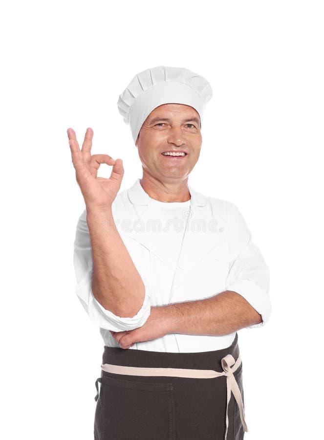 Dojrzały męski szef kuchni pokazuje perfect znaka zdjęcia stock