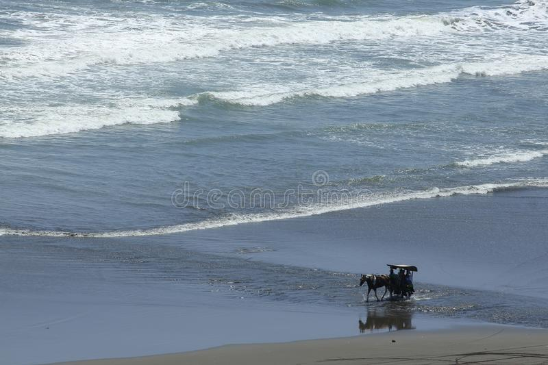 Docked with Horsepower on The Beach. Dokar pulled by horsepower on the beach Pararngtritis become one tourist attraction royalty free stock image