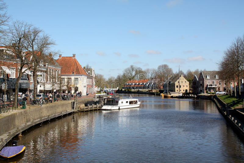 Dokkum. Netherlands. Dokkum. April-18-2015. View over a canal in the city of Dokkum. Netherlands royalty free stock photos