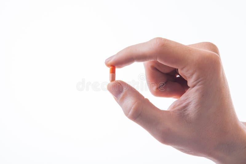 Doktor bietet Tabletten an stockbild