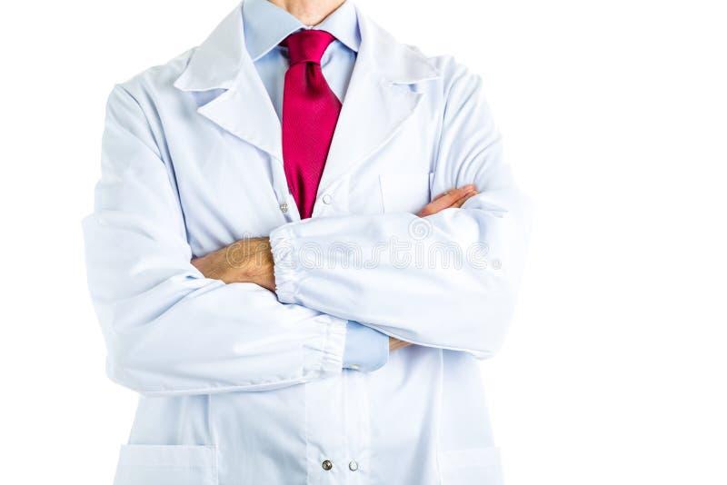 Doktor in den weißen Mantelüberfahrtarmen stockbilder