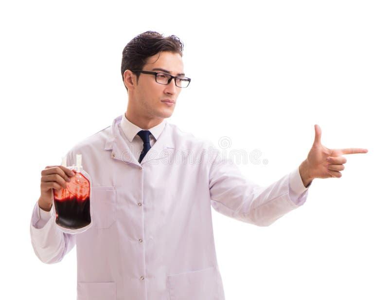 Doktor i begrepp f?r bloddonation som isoleras p? vit arkivfoton