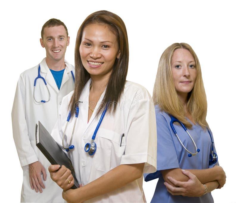 Doktor, Krankenschwester und Internierter stockfotos