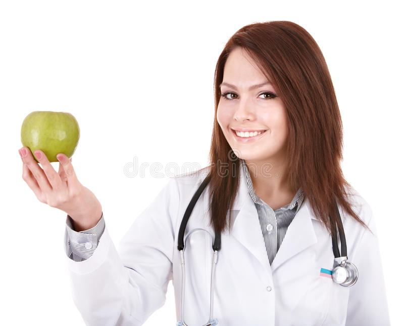 Doktor mit dem Stethoskop, das grünen Apfel. anhält. lizenzfreies stockbild
