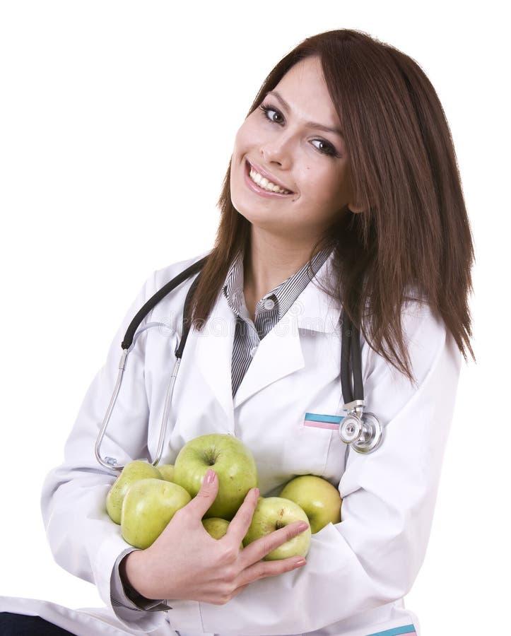 Doktor mit grünen Äpfeln des Stethoskops und der Gruppe. lizenzfreie stockbilder