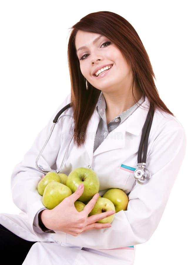 Doktor mit grünen Äpfeln des Stethoskops und der Gruppe. lizenzfreie stockfotografie
