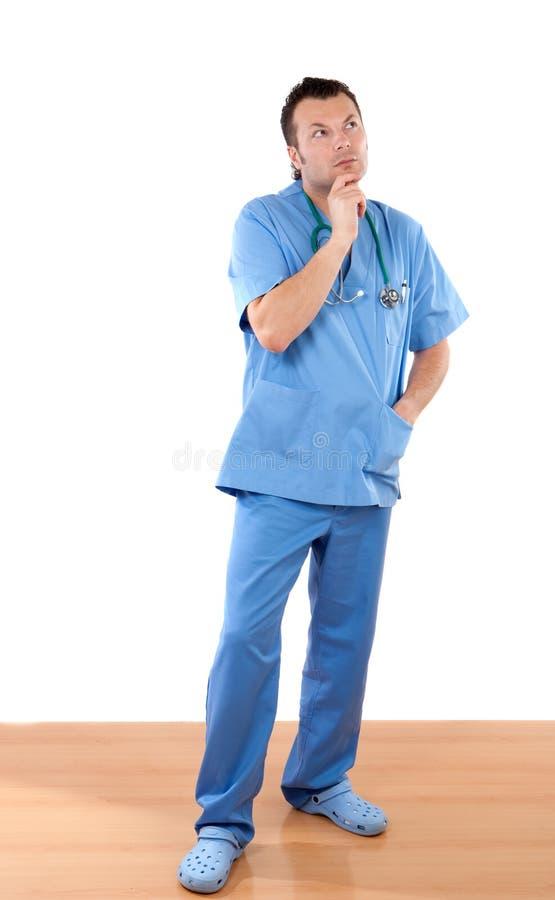 Doktor mit nachdenklicher Geste lizenzfreie stockfotos
