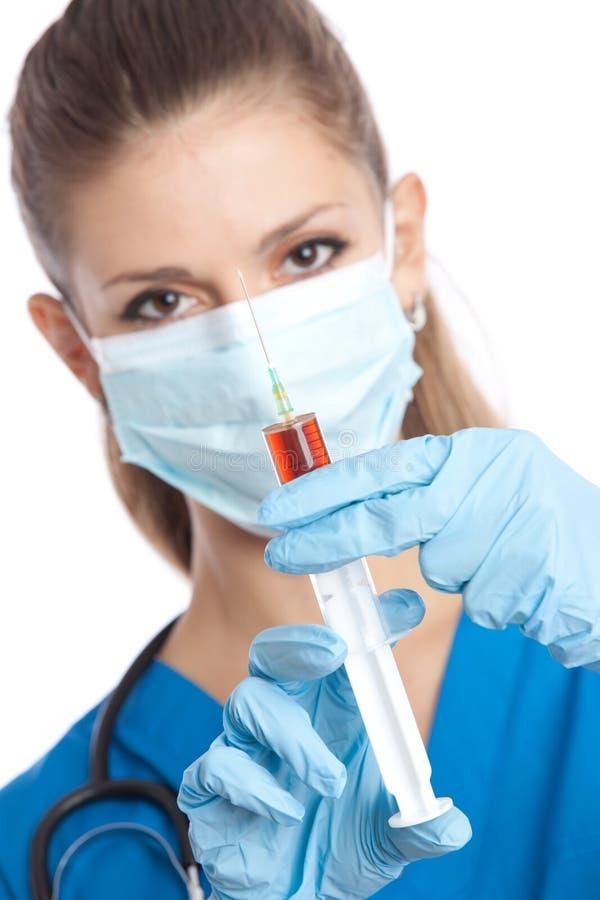 Doktor mit Spritze stockfotos