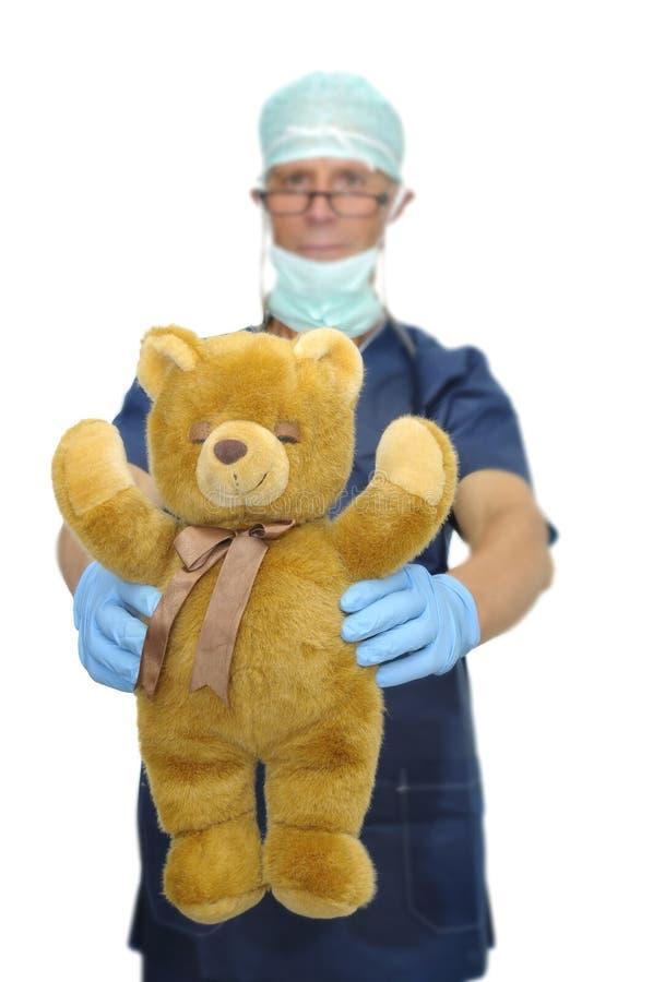 Download Doktor mit Teddybären stockfoto. Bild von erwachsener - 9099968