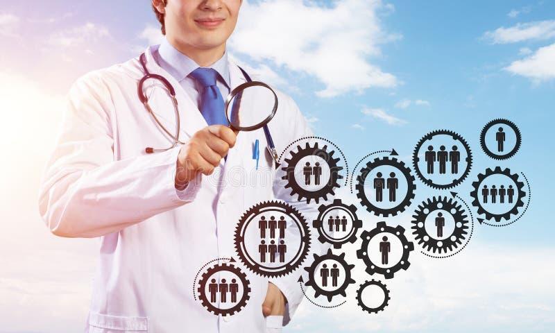 Doktor och teamworkprocess arkivbild