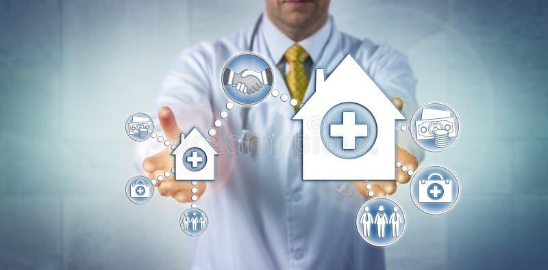 Doktor Offering Merger Of kleines und großes Krankenhaus stockfoto