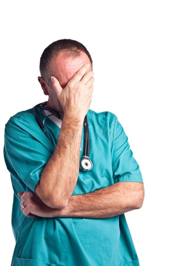 Doktor scheuert innen sich stockbilder