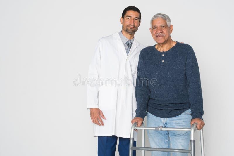 Doktor With Senior arkivfoto