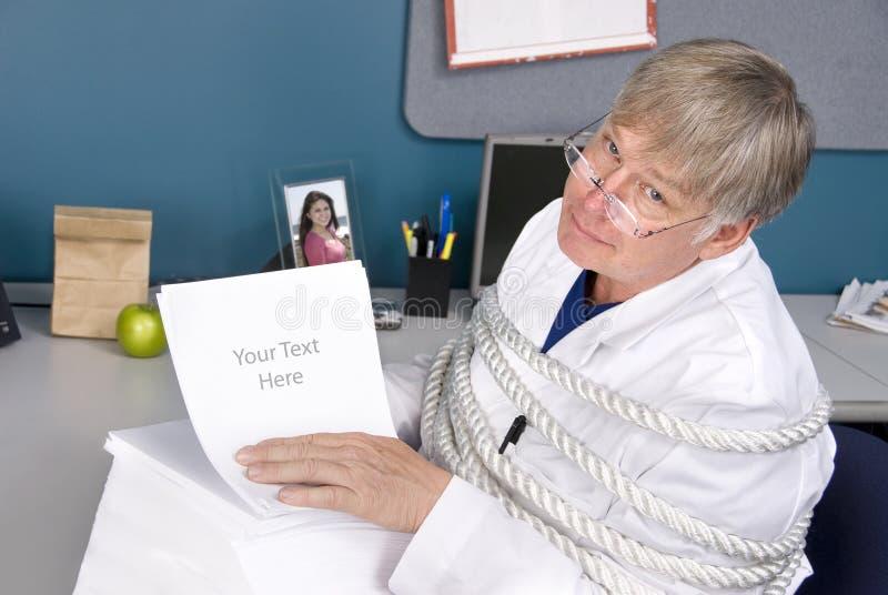 Doktor und Bürokratie lizenzfreies stockbild
