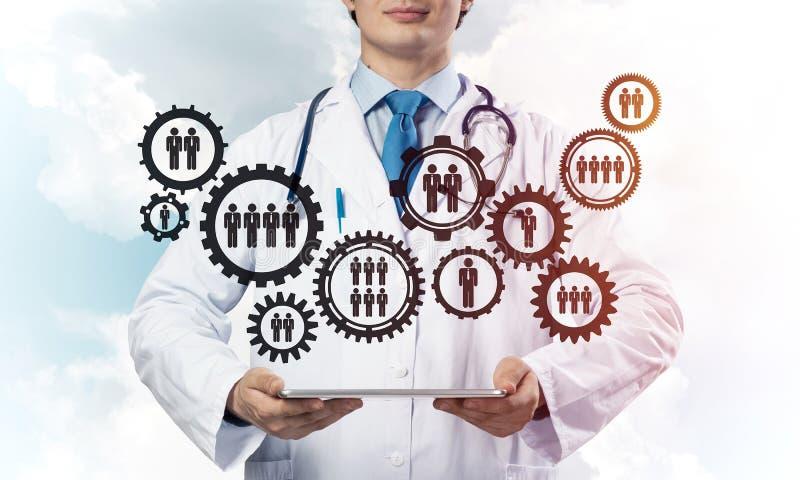 Doktor und Teamwork-Prozess lizenzfreie stockbilder