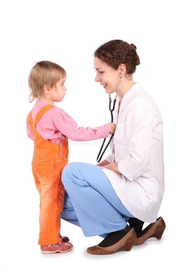 Doktor y niño de la mujer fotos de archivo libres de regalías
