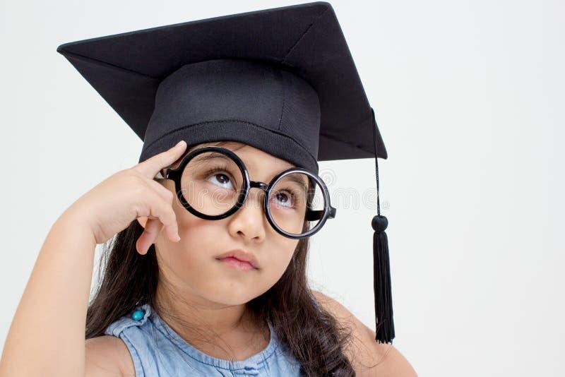 Doktorand- tänka för asiatisk skolaunge arkivbilder