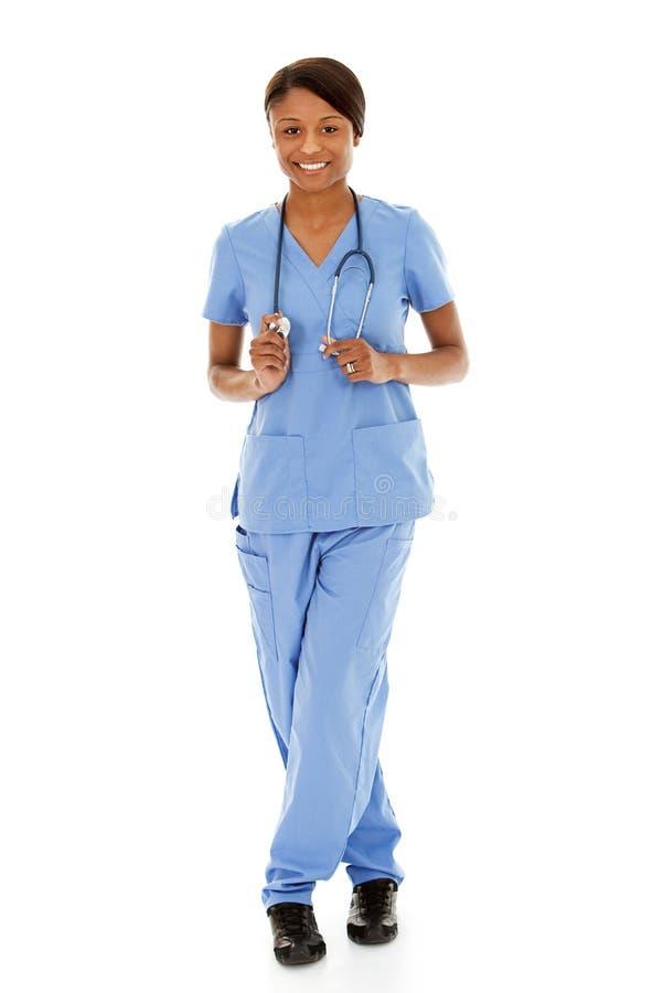 Doktoren: Weibliche Krankenschwester auf weißem Hintergrund lizenzfreie stockfotografie