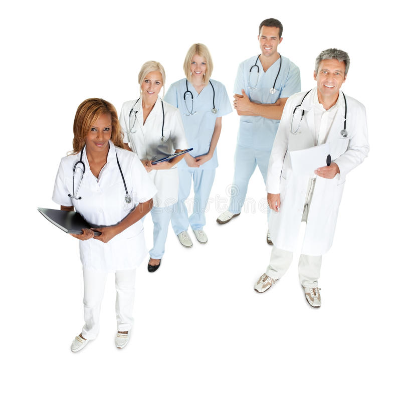 Doktorer och kirurger som ser upp på vit fotografering för bildbyråer