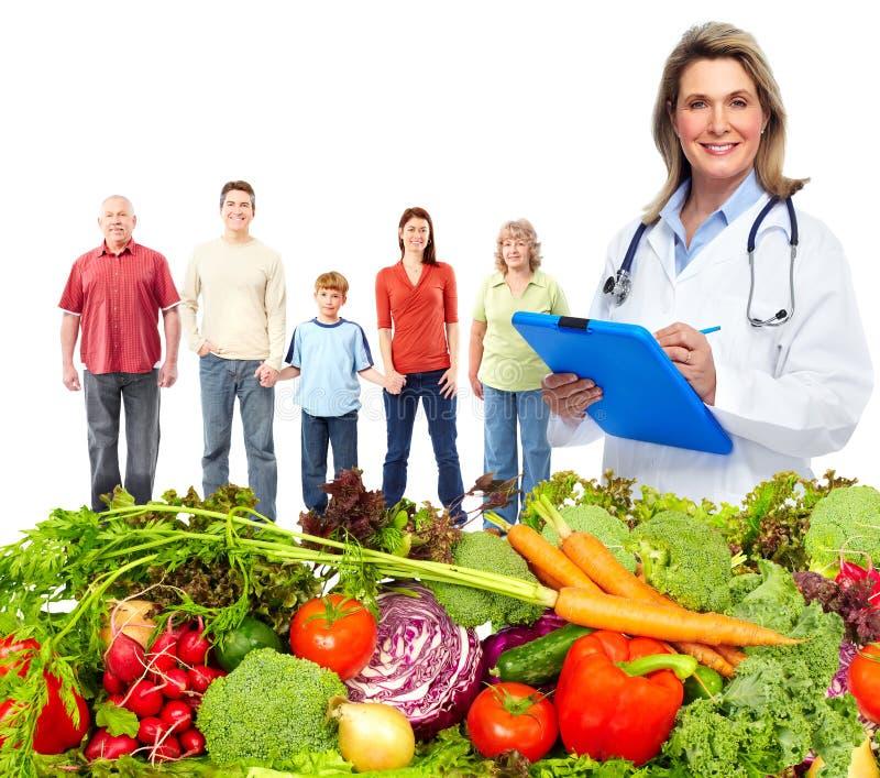 Doktorernährungswissenschaftler und -familie lizenzfreie stockfotografie