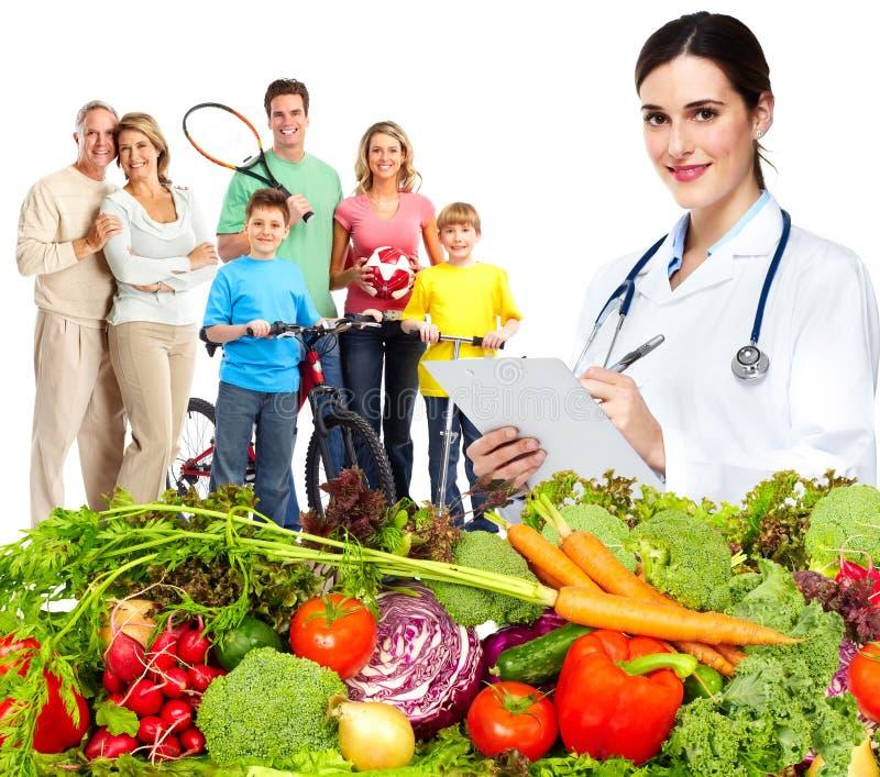 Doktorernährungswissenschaftler und -familie stockbild